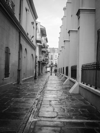 An alleyway in New Orleans French Quarter with lampposts