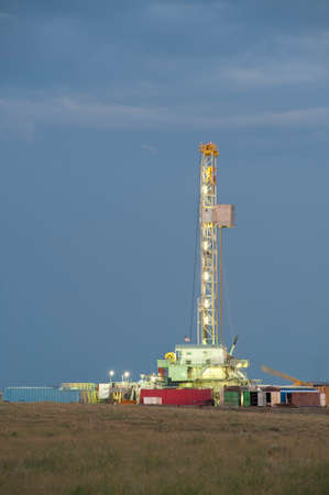 well: A well drilling rig works in the eastern plains of Colorado to reach the Niobrara Shale formation.  Once the well is drilled and perforated, water, sand and chemicals will be injected under high pressure to fracture the shale, releasing oil and gas.