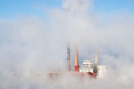 generating station: Air Pollution.  Smoke rises from a coal fired power plant. Stock Photo