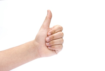 Hand Signalling Thumbs Up Isolated on white Stock Photo - 9819699