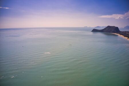 This unique photo shows the beach of Paknampran and the sea, the Gulf of Thailand and a rock formation on a summer day. The picture is a drone photo!