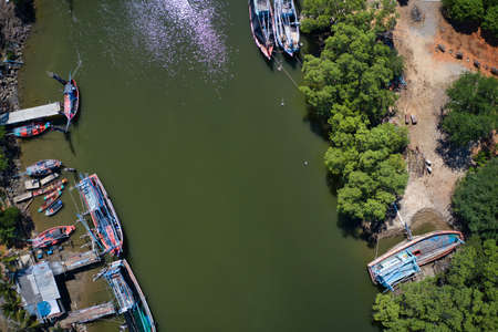 This unique photo shows the beautiful landscape of Pak Nam Pran in Thailand. It's the gorgeous tropical landscape to see the river and the boats on it