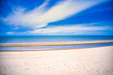 This unique photo shows the beach of Pak Nam Pran in Thailand at low tide and with a bright blue but slightly cloudy sky in summer. Reklamní fotografie