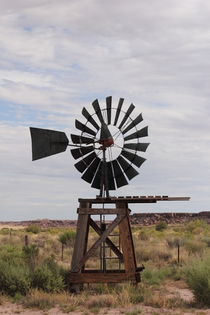 An antique windmill in desert landscape. Stock Photo - 10345387