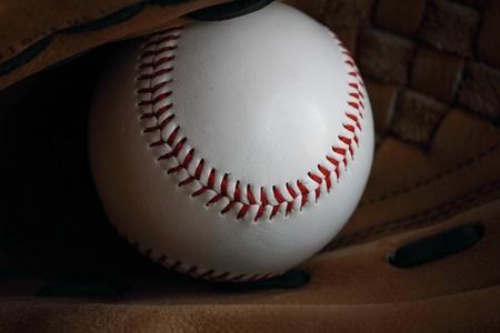 ballgame: Baseball in mitt. Stock Photo