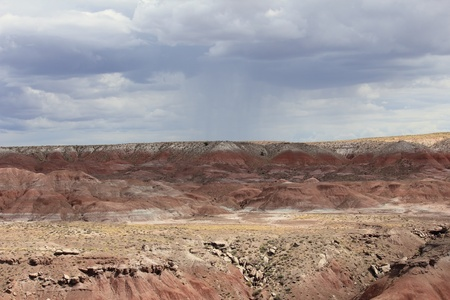 timeless: A scenic view of a monsoon thunderstorm over the Painted Desert in the Petrified Forest National Park. Stock Photo