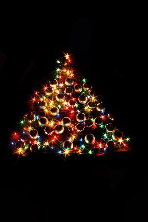 �rbol de Navidad de color sobre el fondo negro Foto de archivo - 1830947