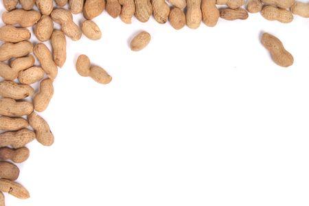 arachis: many fresh peanuts on the white background Stock Photo