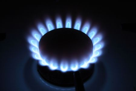 gas from the kitchen (flame on the black background) photo