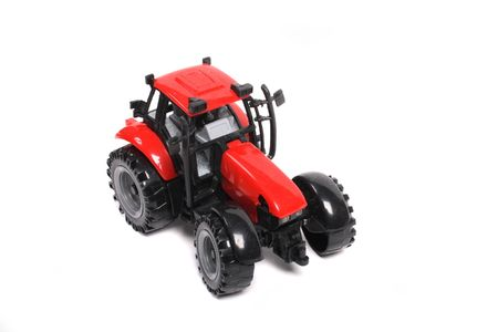 agronomics: red tractor toy on the white background