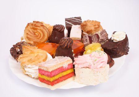 many sweet deserts on the white background photo