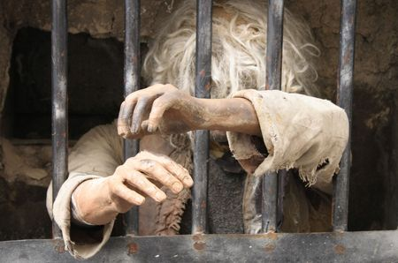 prisoner in the window of the old tower Stock Photo