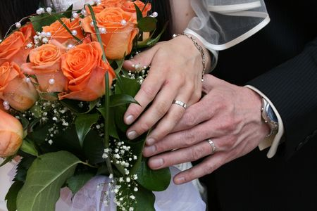 nice orange roses from the wedding and hands  photo