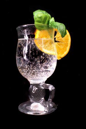 fresh drink with orange on the black background photo