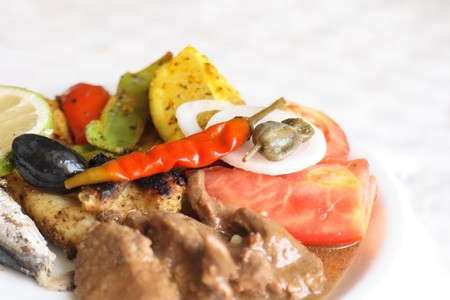 gourmet food with meat tomato and olives photo