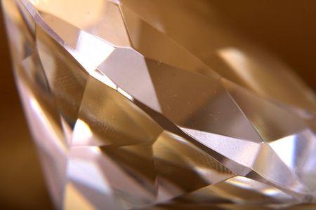 nice diamond on the golden background Stock Photo - 5038882