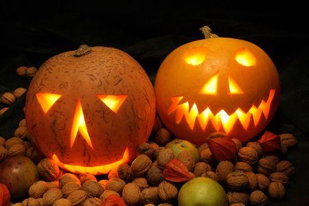 nice halloween pumpkins on the black background photo