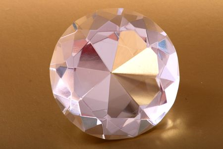 very nice diamond isolated on the golden background Stock Photo - 5405228