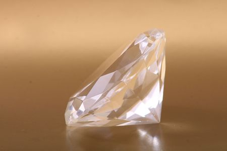 very nice diamond isolated on the golden background Stock Photo - 5405075