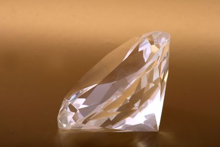 nice diamod isolated on the golden background Stock Photo - 5405309