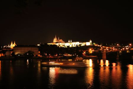 old buildings in Prague in the night - castle photo