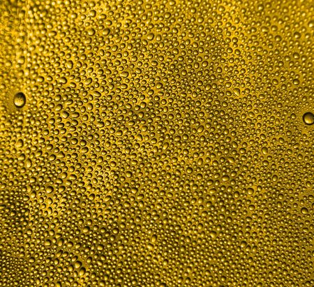 beer background: cold gold beer texture as very nice drink background