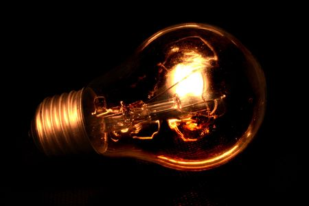 socle: light bulb isolated on the black background Stock Photo