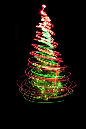 christmas tree form the color lights on the black background Stock Photo - 8311289