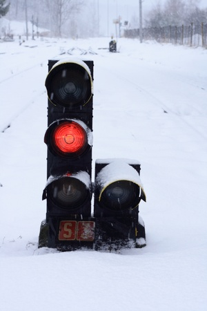 wheather: small train stoplight  in the snowy wheather
