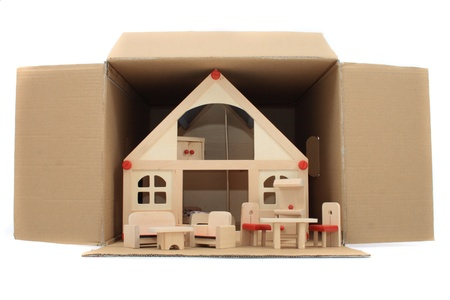 house toy in the paper box as reality decoration photo