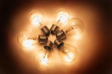 six light bulbs in the dark night photo