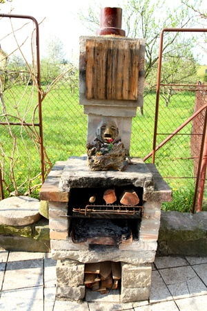 home made outdoor fireplace in the garden  photo