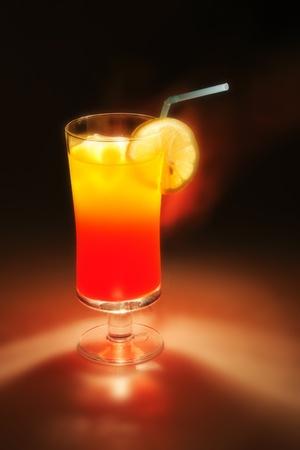 fresch orange and lemon drink in the dark night photo