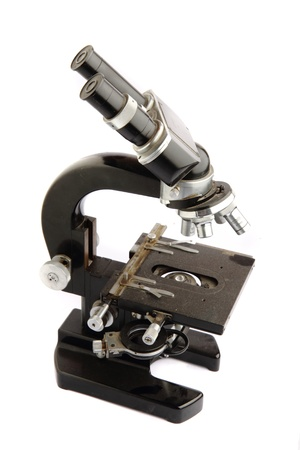 old microscope isolated on the white background Stock Photo - 9913266