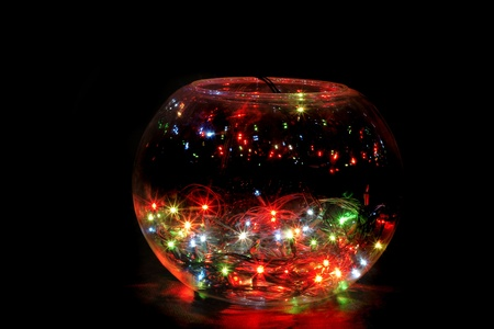 christmas glass sphere with color lights in the dark night photo