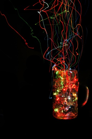 empty christmas glass cup with color lights in the dark night photo