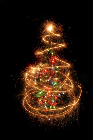 christmas tree from the sparklers in the dark night photo