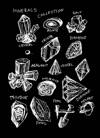 different crystals isolated on the black board