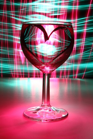valentine heart in the glass of water in the dark night Stock Photo - 12320078