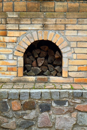 old fireplace with fire wood as nice background Stock Photo - 12320212