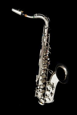 silver saxophone isolated on the black background Stock Photo