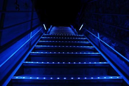 暗い夜の灯青い階段 写真素材