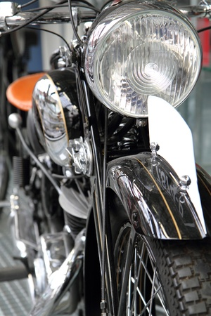 detail of old motorbike in the black and silver colors  photo
