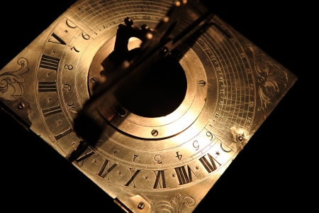 golden sundial beneath as very nice historical background photo