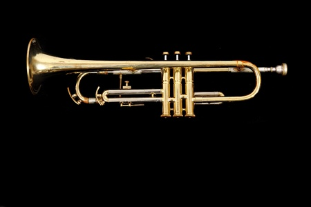 gold trumpet isolated on the black background Stock Photo - 13203662