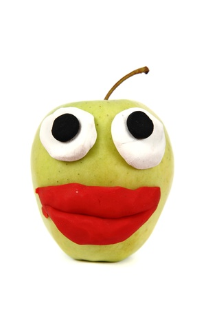 green apple with plasticine smile isolated on the white background Stock Photo - 13559925