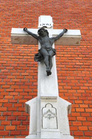 crucifix religion symbol on the old  brick wall photo