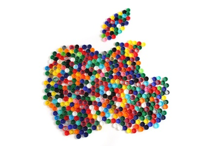 re design: apple from the color plastic caps isolated on the white background