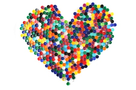 heart from the color plastic caps isolated on the white background