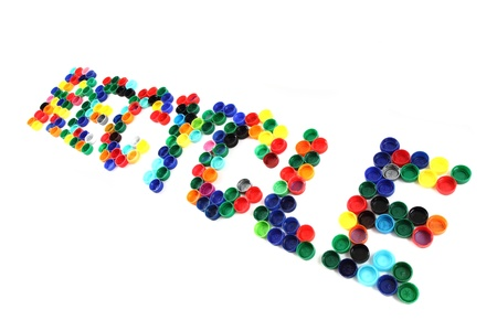 re design: word recycle from color plastic caps isolated on the white background Stock Photo